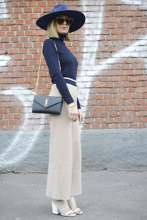 Clothing, Hat, Sleeve, Brick, Shoulder, Joint, Collar, Outerwear, Style, Brickwork,