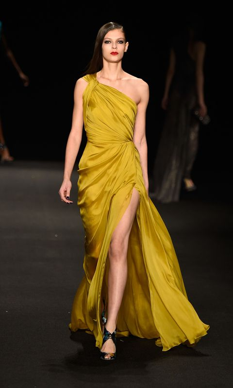 Yellow, Hairstyle, Shoulder, Dress, Joint, Fashion show, Fashion model, Formal wear, Style, One-piece garment,