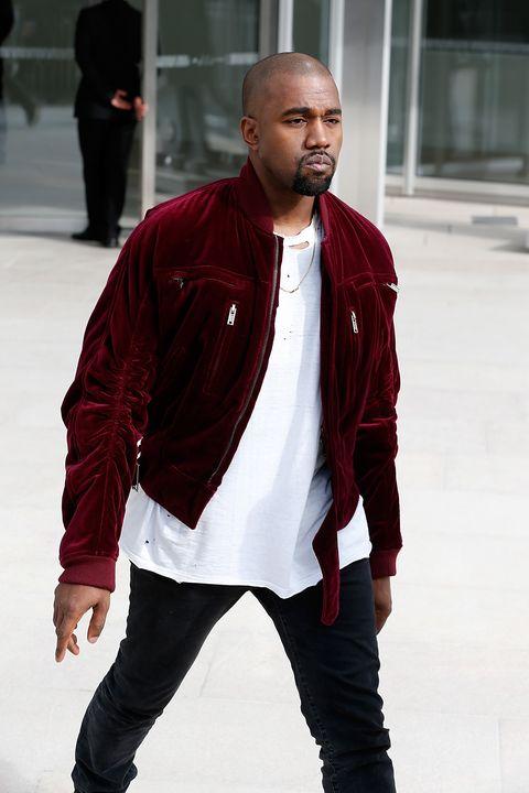 Kanye West wearing a velvet jacket at Paris Fashion Week
