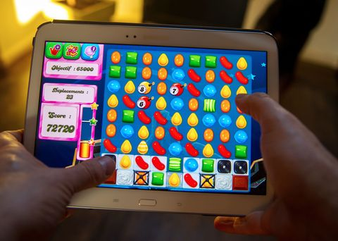 Man playing candy crush on a tablet
