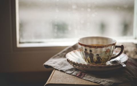Cup of tea in a china cup next to a window
