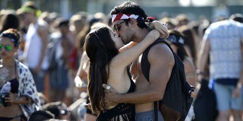 Couple kissing at Coachella festival