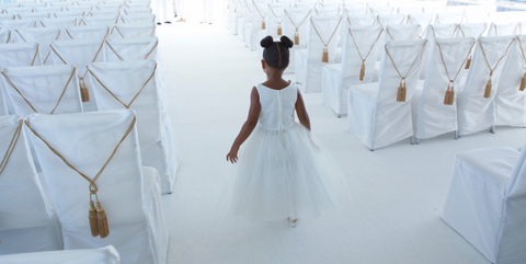 Blue Ivy looks ridiculously cute in these pictures from grandmother Tina Knowles' wedding