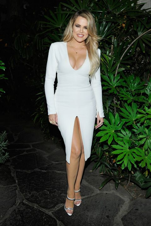 Khloe Kardashian chilling outside with some bushes at the Calvin Klein party