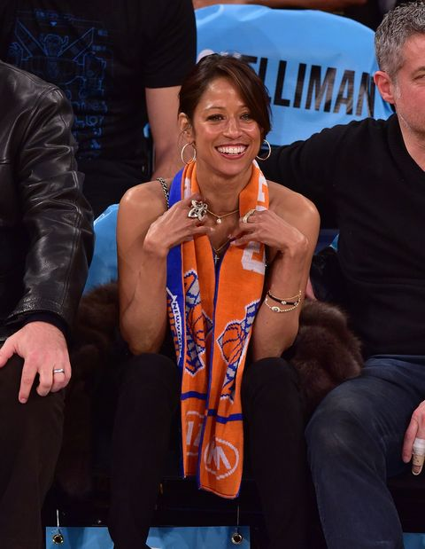 Stacey Dash sitting courtside at a basketball game