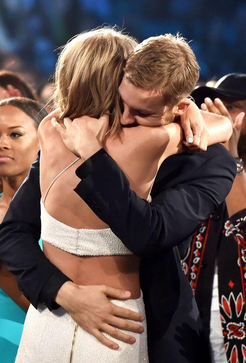 Taylor Swift and Calvin Harris hugging at the Billboard Awards