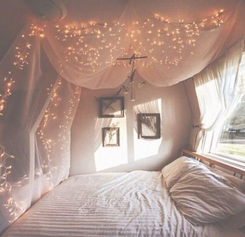 1 sleep under the stars with clever use of fairy lights and floaty fabric