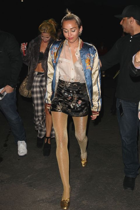 Miley Cyrus wearing gold glittery tights