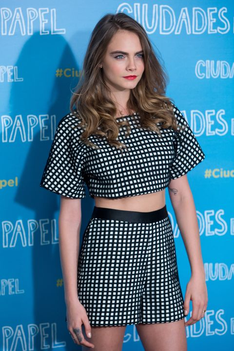 Cara Delevingne wearing black and white checked co-ords