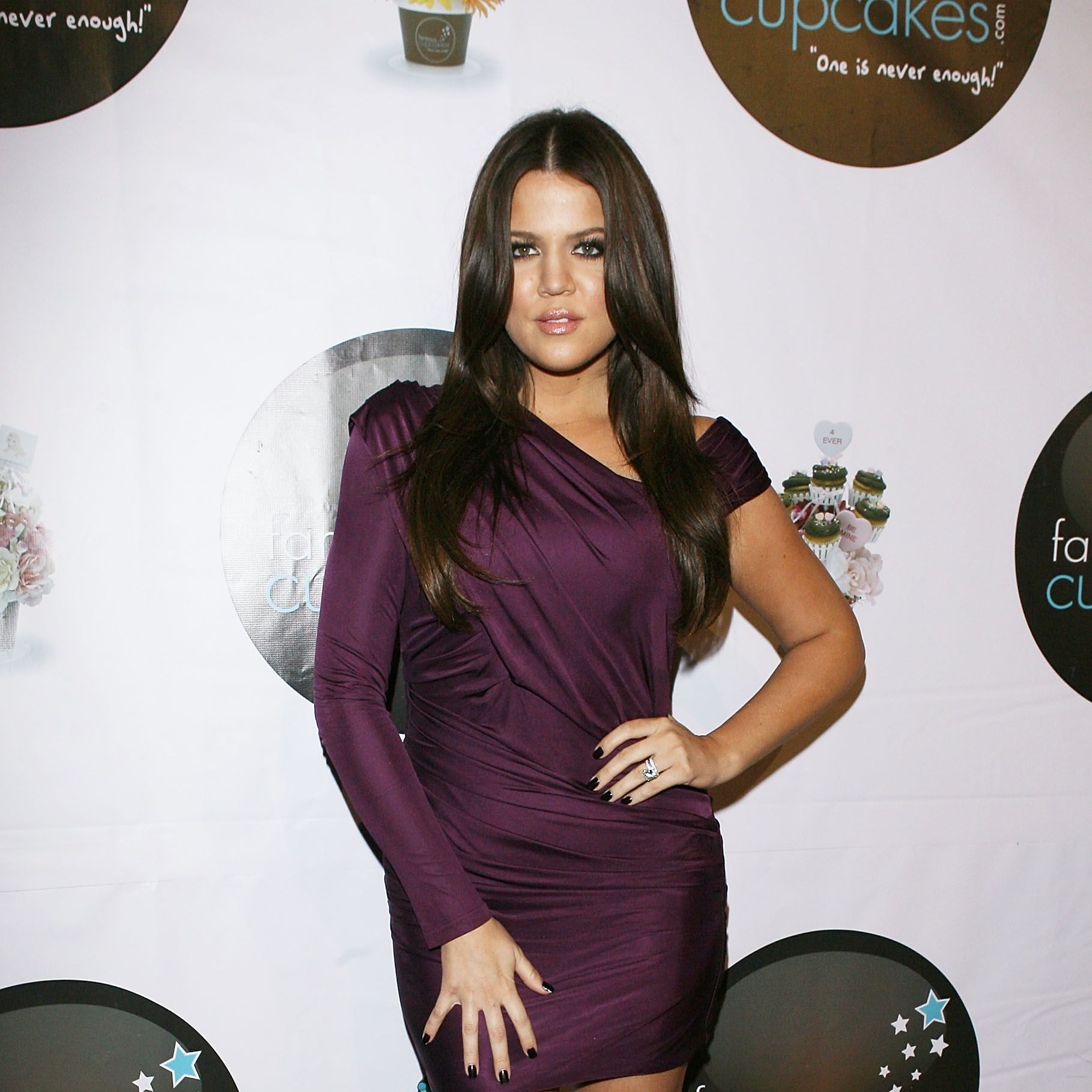 We love this deep berry hue on Khloe's sunkissed skin tone - and her figure really rocks the asymmetrical shape!