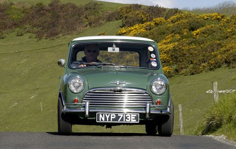 Vintage mini cooper driving through the countryside