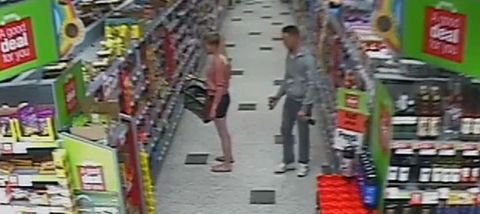 Guy taking photos of girl's bum in the supermarket