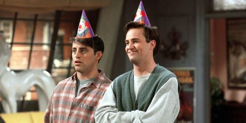 Joey and Chandler with party hats in Friends