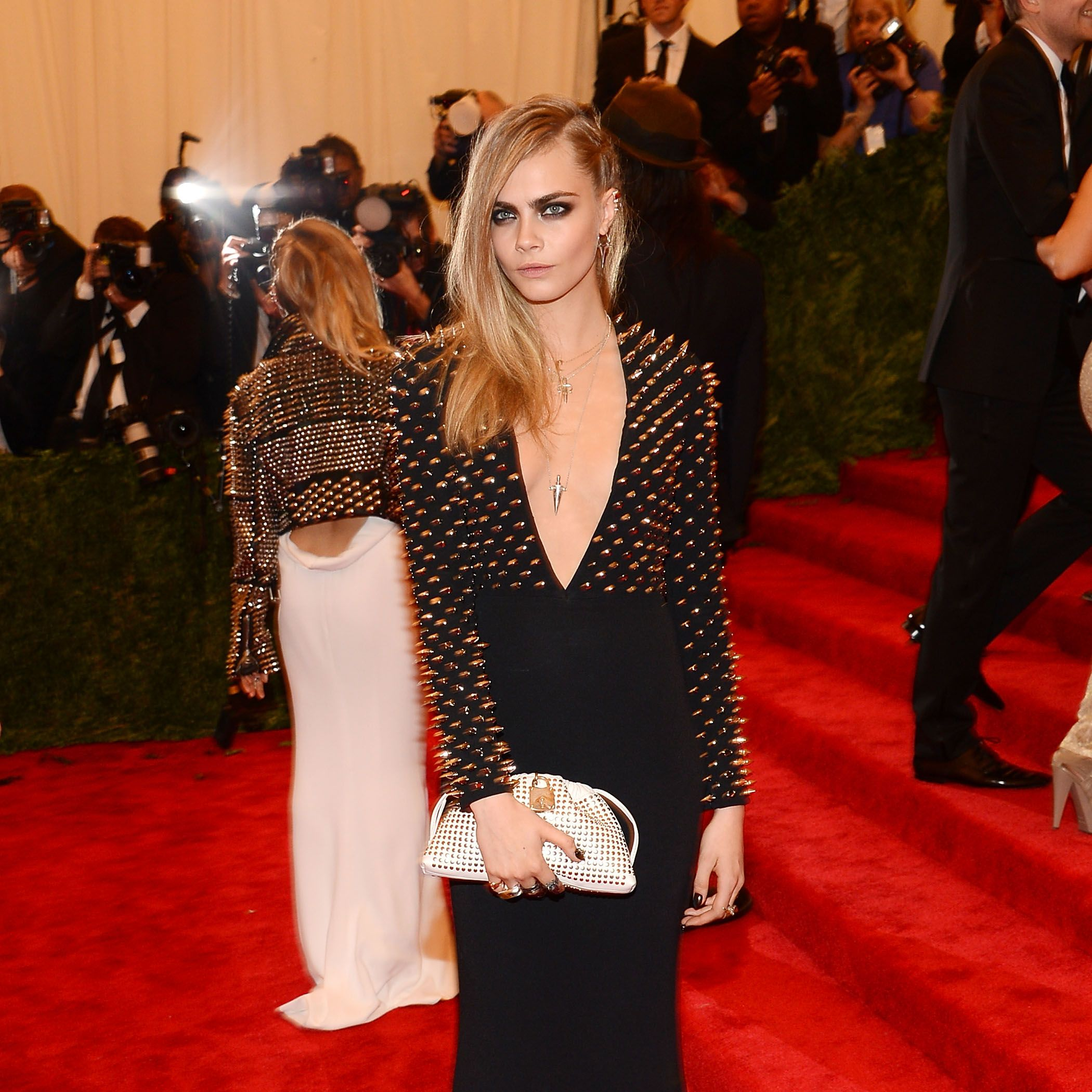 "NEW YORK, NY - MAY 06:  Cara Delevingne attends the Costume Institute Gala for the ""PUNK: Chaos to Couture"" exhibition at the Metropolitan Museum of Art on May 6, 2013 in New York City.  (Photo by Larry Busacca/Getty Images)"