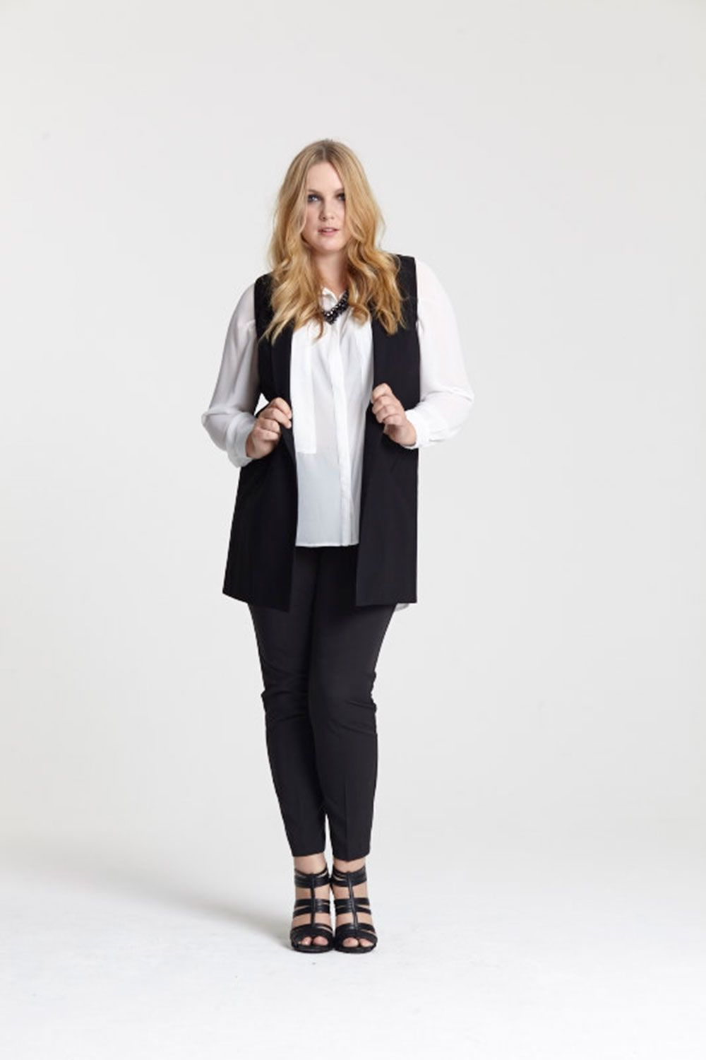 """<a target=""""_blank"""" href=""""http://www.evans.co.uk/en/evuk/product/clothing-250468/as-seen-on-the-catwalk-4743483/evans-black-sleeveless-jacket-4741693?bi=1&ps=20&cat1=209427&cat2=2577822&productId=21367849&cmpid=par_1_cosmo_wk3_fashfest_03J22TBLK"""">Buy the waistcoat</a>, <a target=""""_blank"""" href=""""http://www.evans.co.uk/en/evuk/product/clothing-250468/as-seen-on-the-catwalk-4743483/evans-black-tapered-trousers-4023275?bi=1&ps=20&cat1=209427&cat2=2577822&productId=16764922&cmpid=par_1_cosmo_wk3_fashfest_03R18RBLK"""">trousers</a>, <a target=""""_blank"""" href=""""http://www.evans.co.uk/en/evuk/product/clothing-250468/as-seen-on-the-catwalk-4743483/collection-ivory-panel-shirt-4717710?bi=1&ps=20&cat1=209427&cat2=2577822&productId=21204003&cmpid=par_1_cosmo_wk3_fashfest_07C01TIVR"""">shirt</a>, <a target=""""_blank"""" href=""""http://www.evans.co.uk/en/evuk/category/clothing-250468/as-seen-on-the-catwalk-4743483?cat1=209427&cat2=2577822&cmpid=par_1_cosmo_wk3_fashfest_jetnecklace"""">necklace</a> and <a target=""""_blank"""" href=""""http://www.evans.co.uk/en/evuk/category/clothing-250468/as-seen-on-the-catwalk-4743483?cat1=209427&cat2=2577822&cmpid=par_1_cosmo_wk3_fashfest_blacksandal"""">heels</a>"""