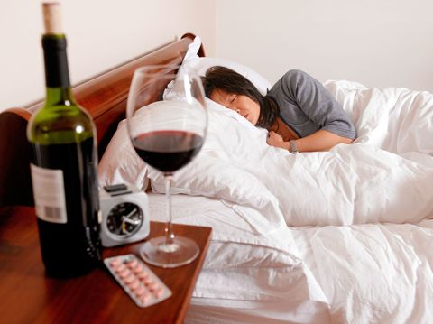 Sleeping next to a bottle of wine