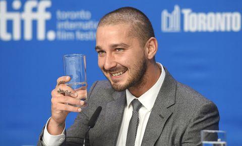 Shia LaBeouf drinking water at the toronto international film festival