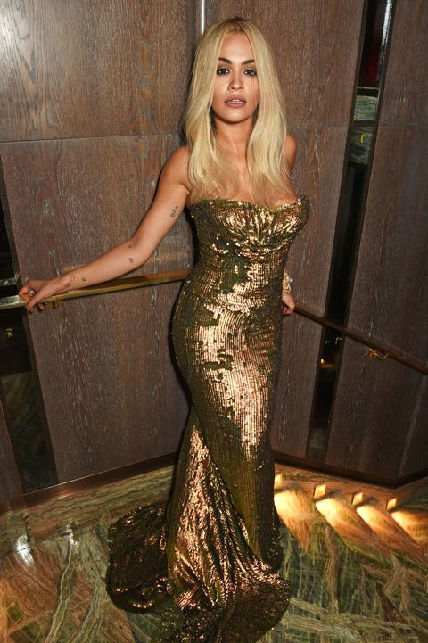 Rita Ora wearing a gold dress at the launch of sexy fish