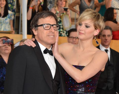 Jennifer Lawrence strokes David O. Russell's face at the Golden Globes