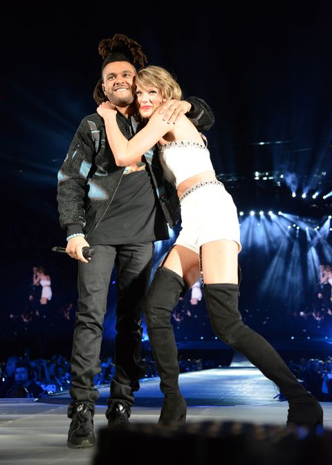 Taylor Swift and the Weeknd hugging onstage