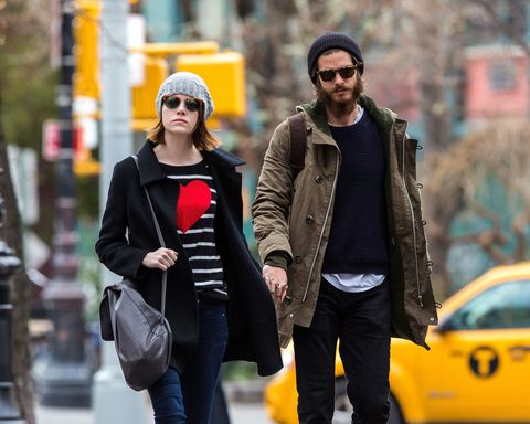 Andrew Garfield and Emma Stone holding hands