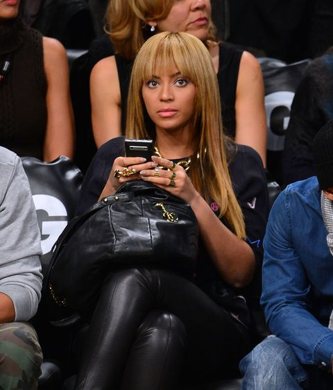Beyonce on her phone