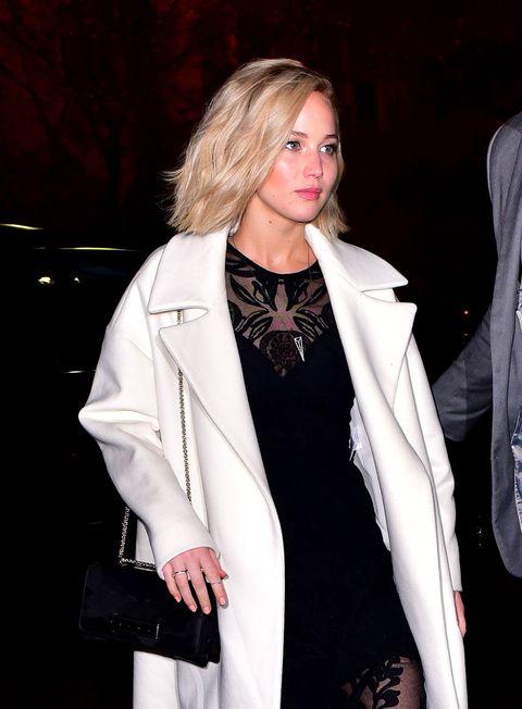 Jennifer Lawrence wearing a cream white coat in New York City, November 2015