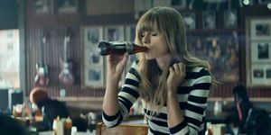 Taylor Swift with a diet coke