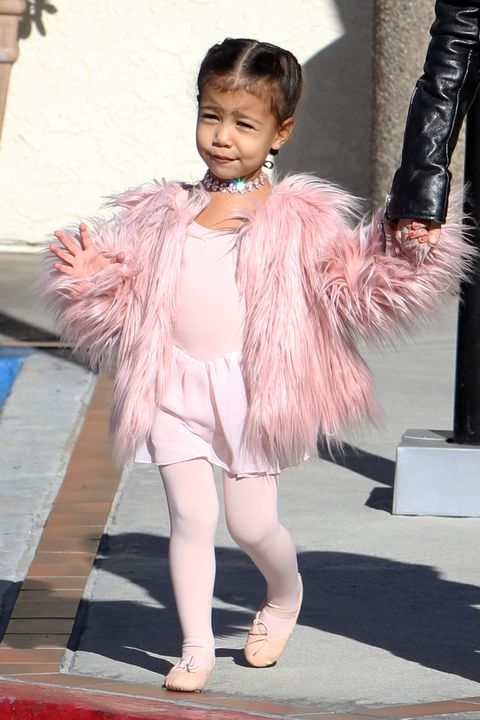 North West wearing a pink fluffy coat to ballet