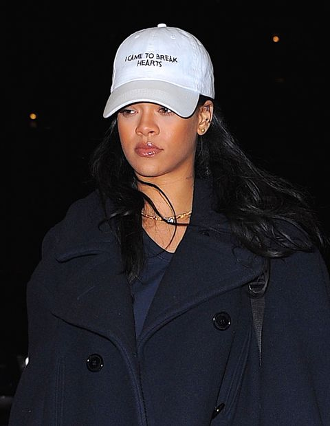Rihanna wearing an I Came to Break Hearts cap while out in New York