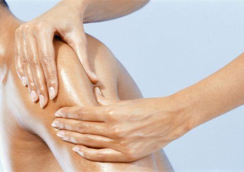 Woman giving man massage