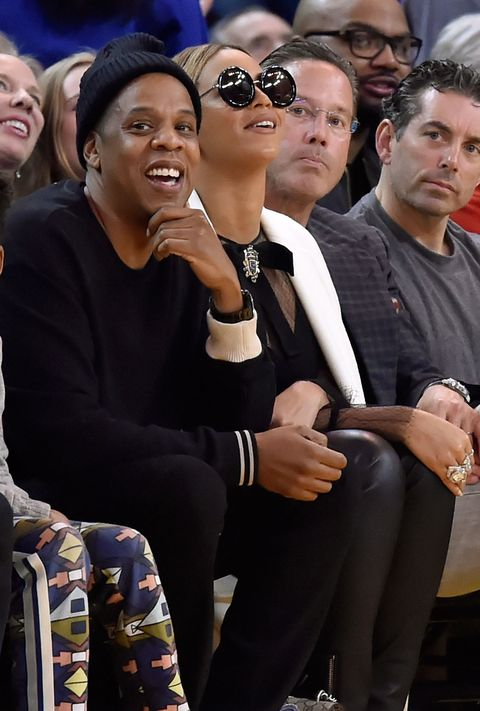 Jay Z and Beyonce at a basketball game