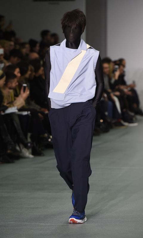 Footwear, Fashion show, Trousers, Shoulder, Shirt, Joint, Outerwear, Runway, Style, Dress shirt,