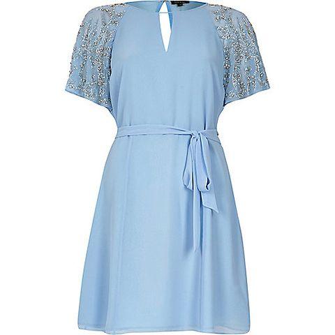 "<p>£65, <a href=""http://www.riverisland.com/women/dresses/party--evening-dresses/blue-embellished-sleeve-dress-679898"" target=""_blank"">River Island</a></p>"