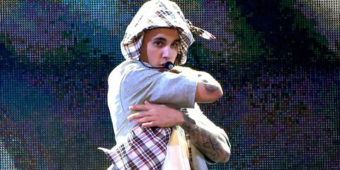 Justin Bieber hugging himself while performing on stage