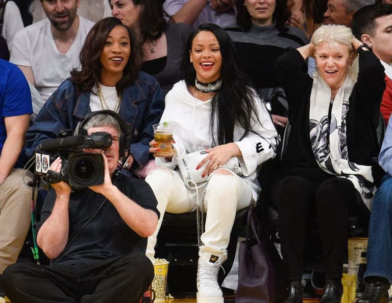 Rihannas free meet and greets with her fans look like the most fun ever rihanna sitting courtside at the lakers basketball game in la m4hsunfo