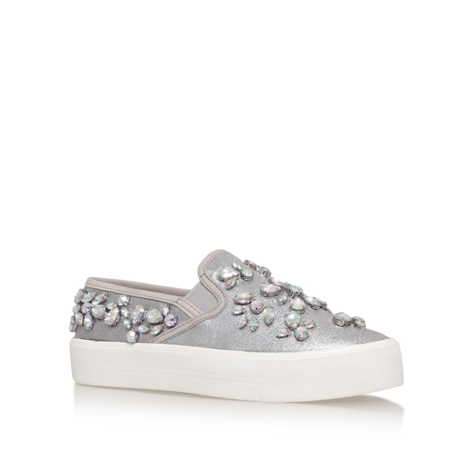 20 pairs of shiny silver trainers to