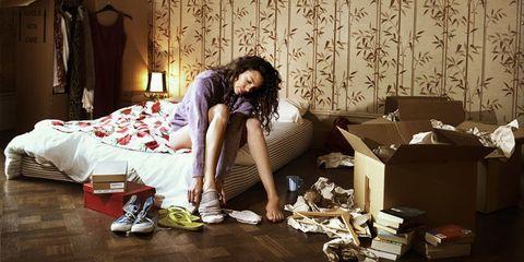 Woman in messy bedroom Cosmopolitan