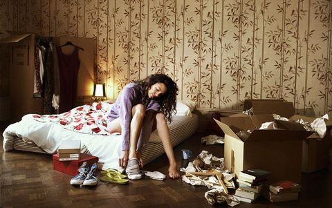 Woman in messy bedroom