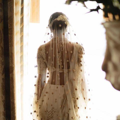 Kresha Bajaj embroiders story of her relationship onto her wedding dress