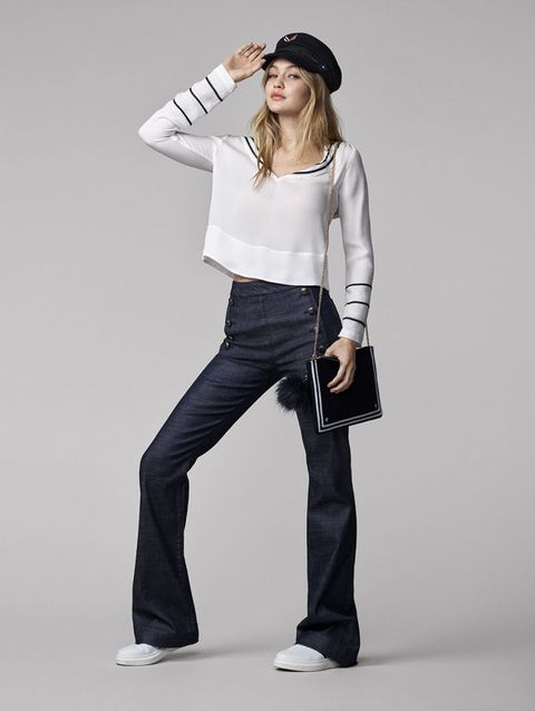 Sleeve, Denim, Shoulder, Shoe, Textile, Standing, Outerwear, White, Jeans, Style,