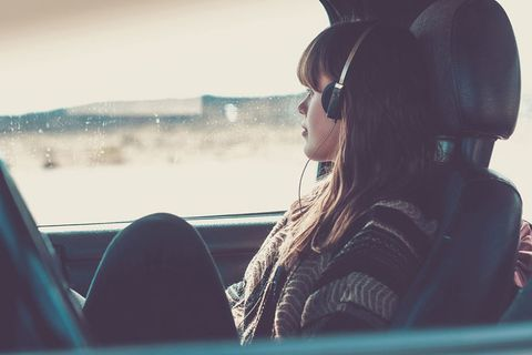woman sitting in the car carsick