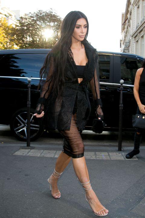 Gigi Hadid's man-handler tries to kiss Kim Kardashian's bum in latest celebrity ambush