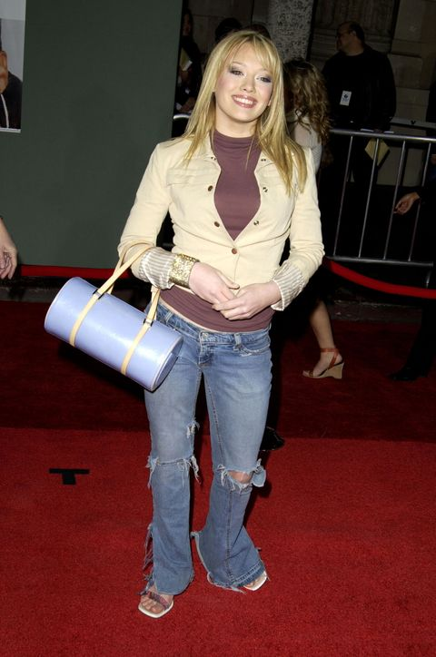 Trousers, Denim, Shoulder, Jeans, Textile, Joint, Outerwear, Style, Bag, Flooring,
