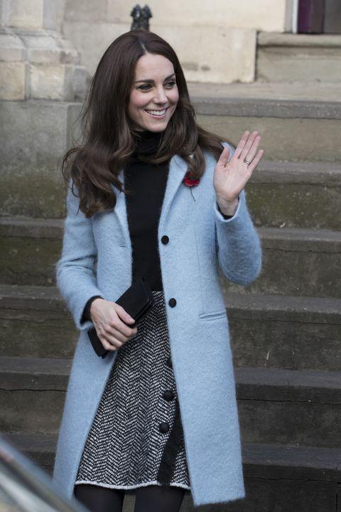 Kate Middleton wearing a pale blue coat