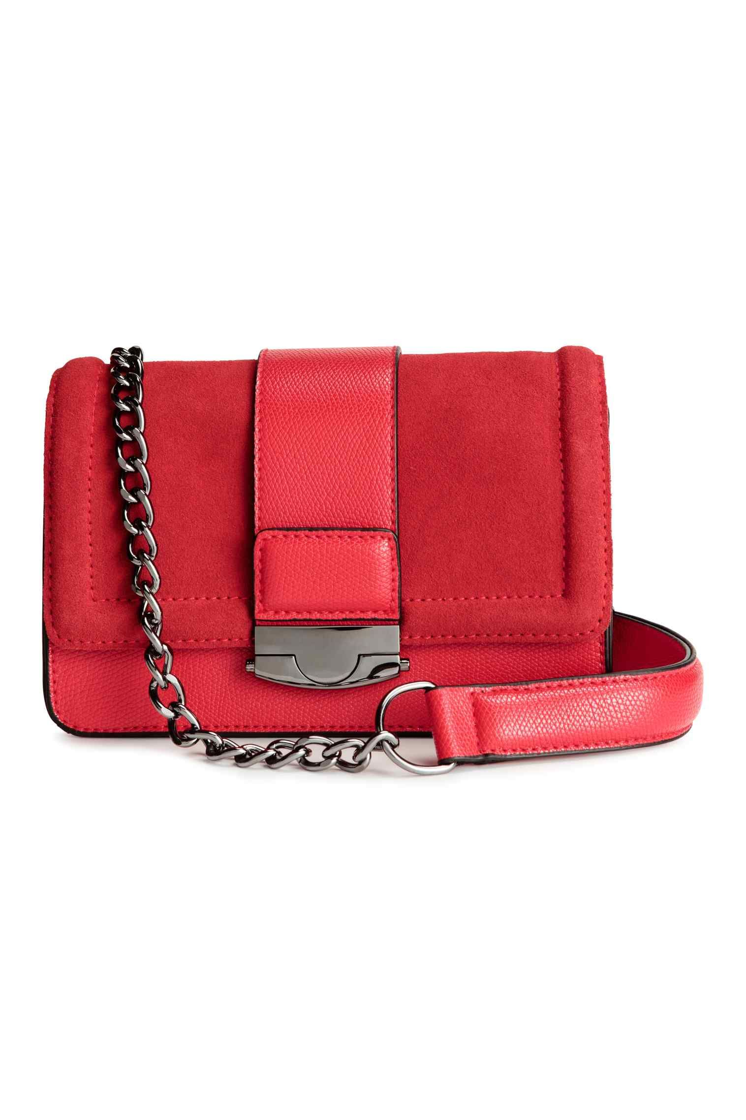 """<p>If you want to wear this bag all day and night, simply tuck the strap inside to transform the crossbody bag into a clutch.</p><p><a href=""""http://www2.hm.com/en_gb/productpage.0387451001.html#"""" target=""""_blank"""">Bag with suede details, £29.99, H&amp&#x3B;M</a></p>"""