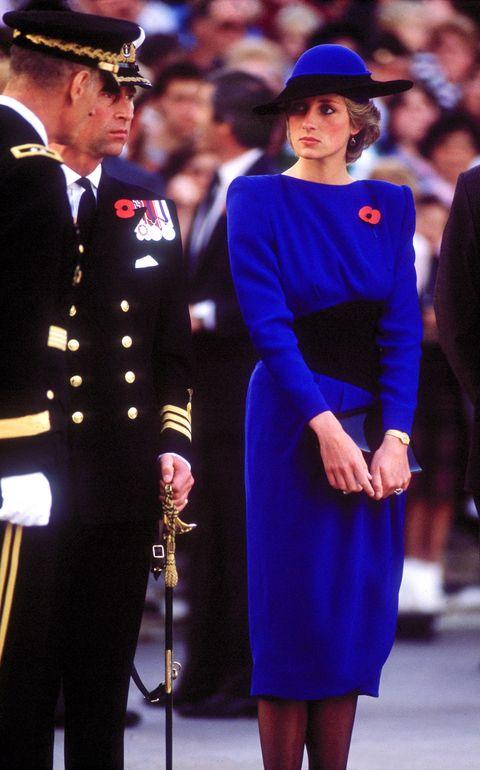 Cobalt blue, Uniform, Dress, Electric blue, Fashion, Event, Joint, Headgear, Performance, Military officer,