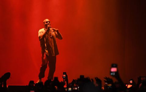Kanye West performing at a festival