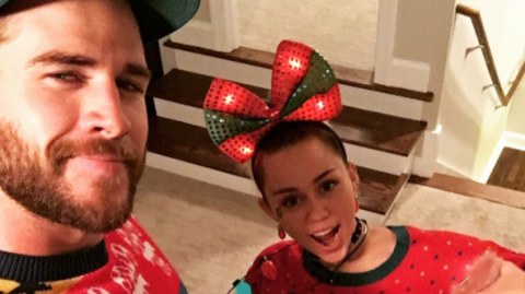 Liam Hemsworth and Miley Cyrus have a STRONG Christmas jumper game