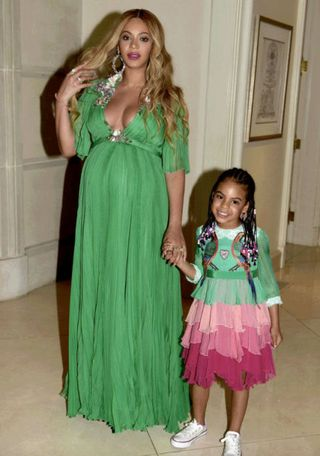 9793ca3ac Blue Ivy wearing a custom Gucci dress to the Beauty and the Beast premiere